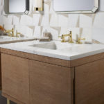 square wooden sink with marble countertop