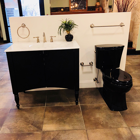 matching black toilet and sink in showroom